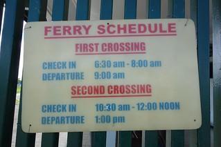 Placa de horários do barco para o Suriname