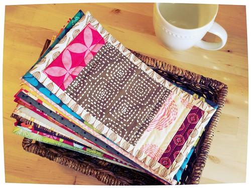 pile of mug rugs