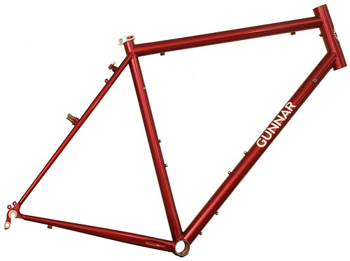 <p>Gunnar Grand Tour in Sunset Red over Brickyard Red with Bullseye Decals.  The Grand Tour incorporates decades of refinements in full road touring frame design, including stable handling at high speeds, a comfortable fit, rugged tubeset, generous chainstays and lots of creature features.</p>