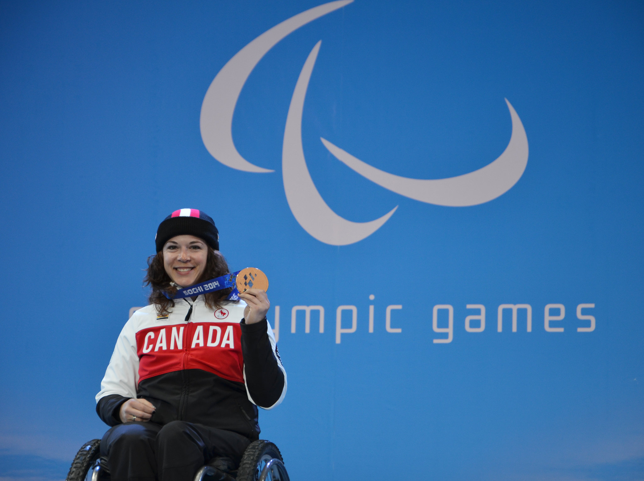 Kim Joines proudly shows off her bronze medal from the slalom event in Sochi, Russia
