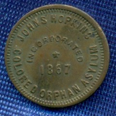 Johns Hopkins Colored Orphan Asylum token obverse