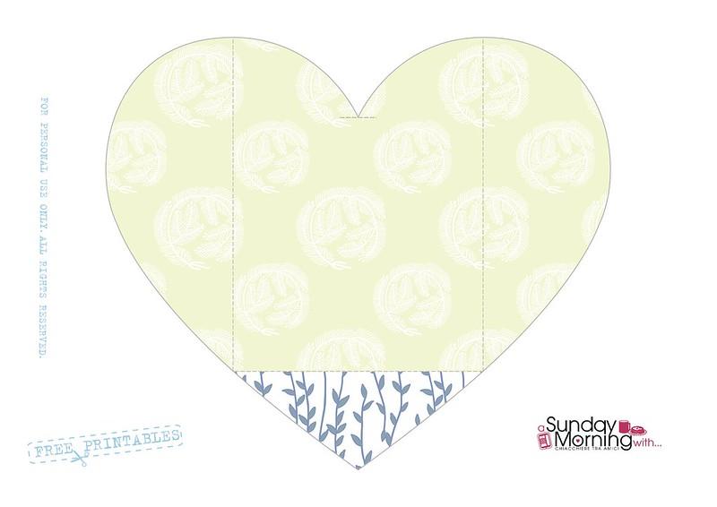 bustina a forma di cuore pattern piume
