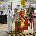 Pueblo Chemical Agent-Destruction Pilot Plant Training Facility ordnance technicians use simulated munitions for maintenance training using a Lift Assist.