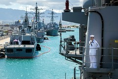 Fire Controlman 2nd Class Michael Klimek mans the rails aboard USS Mobile Bay (CG 53) as the ship prepares to moor at Joint Joint Base Pearl Harbor-Hickam, June 28.  (U.S. Navy/MC2 Ryan J. Batchelder)