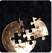 puzzle cut out coin
