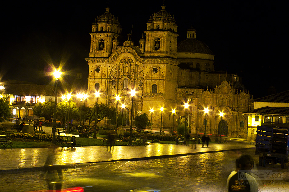 Cuzco's beautiful 'Plaza de Armas' and 'Church of La Compañia' at night.