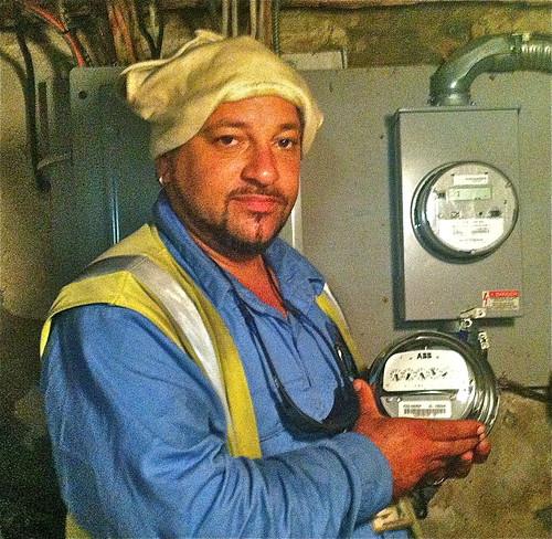 Installs smart RF electric meter
