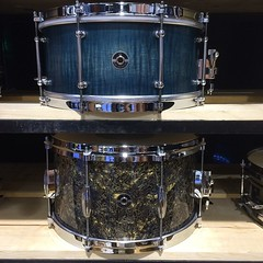 Just a couple of my favorites from our stash of wood snares. 7X14 blue satin stain, 8X14 Topo Gold. #qdrumco #namm2014