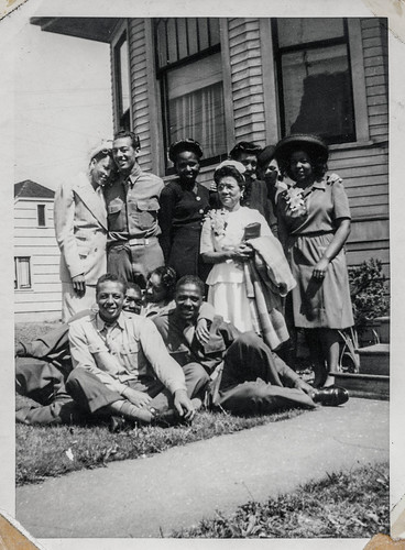 A group of black soldiers pose with their family