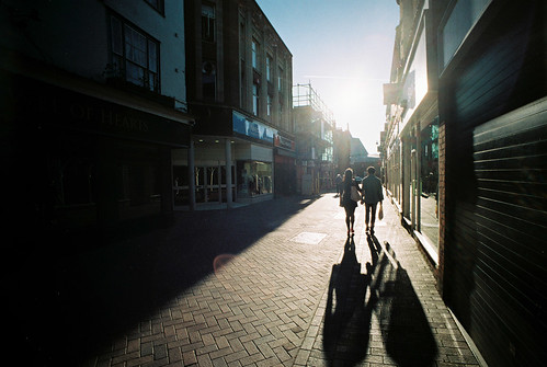A Couple Walking with Shadows