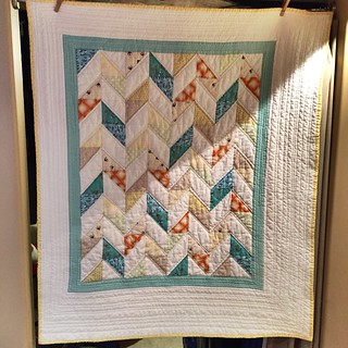 A baby quilt using the Sweet and Sassy Baby Quilt pattern from Cluck Cluck Sew. http://www.cluckclucksew.com/2013/03/sweet-n-sassy-baby-quilt-pattern.html?m=1