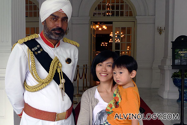 Rachel and Asher with the iconic Raffles Hotel doorman