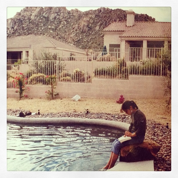 I used to be a bookworm, now I'm just a phoneworm. Still have bad posture though... #tbt #throwbackthursday #reading #arizona #poolside #noseinabook