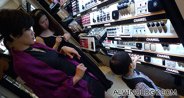 Rachel checking out the duty-free cosmetics