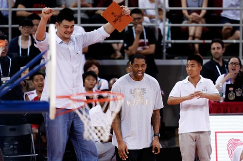 July 1st, 2013 - Yao Ming and Tracy McGrady cheer on their team of young players in the 3rd quarter of the Yao Foundation charity game