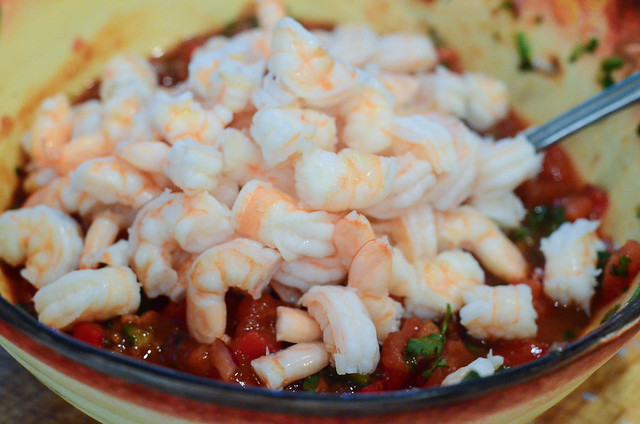 The chopped shrimp are added to the pico de gallo.