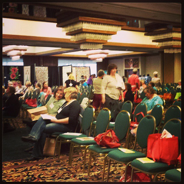 The doors have been open 10 minutes (at least 80 people here already).  Program starts in 50 minutes.  Who can say quilting is dead when 300 ladies (& 3 men) have gathered in Eastern Washington.  Again early morning - sigh #rickytims