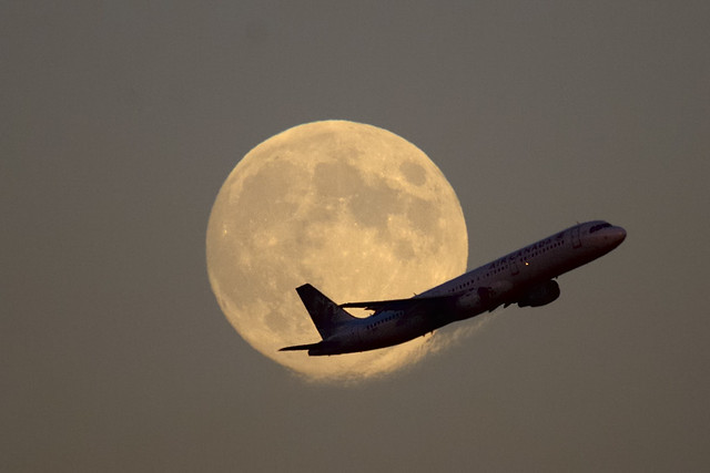 Toronto Pearson - Air Canada Airbus climbing out in front of full Harvest Moon..