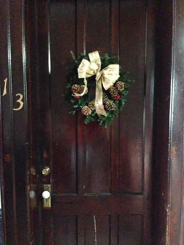 Christmas doorway at #13, thanks to the Presbyterian Church's Wassail Bowl sale. by Michael Tinkler