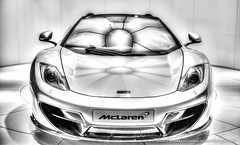 wheel(0.0), mclaren f1(0.0), automobile(1.0), automotive exterior(1.0), vehicle(1.0), mclaren mp4-12c(1.0), automotive design(1.0), mclaren automotive(1.0), bumper(1.0), land vehicle(1.0), luxury vehicle(1.0), supercar(1.0), sports car(1.0),