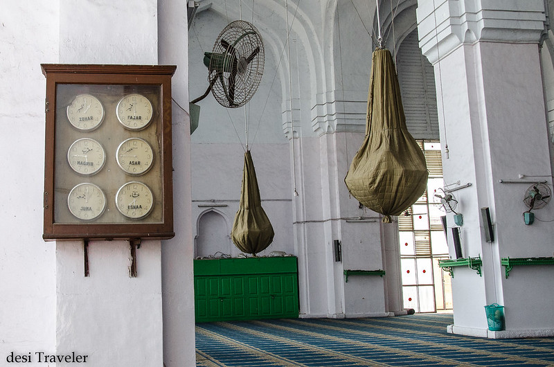 clocks telling prayer timings at Mecca Masjid