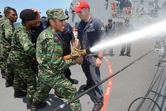 Members of the Timor-Leste Defense Force and U.S. Sailors conduct a firehose handling skills exchange aboard USS Kidd (DDG 100). (U.S Navy/MC1 Jay C. Pugh)