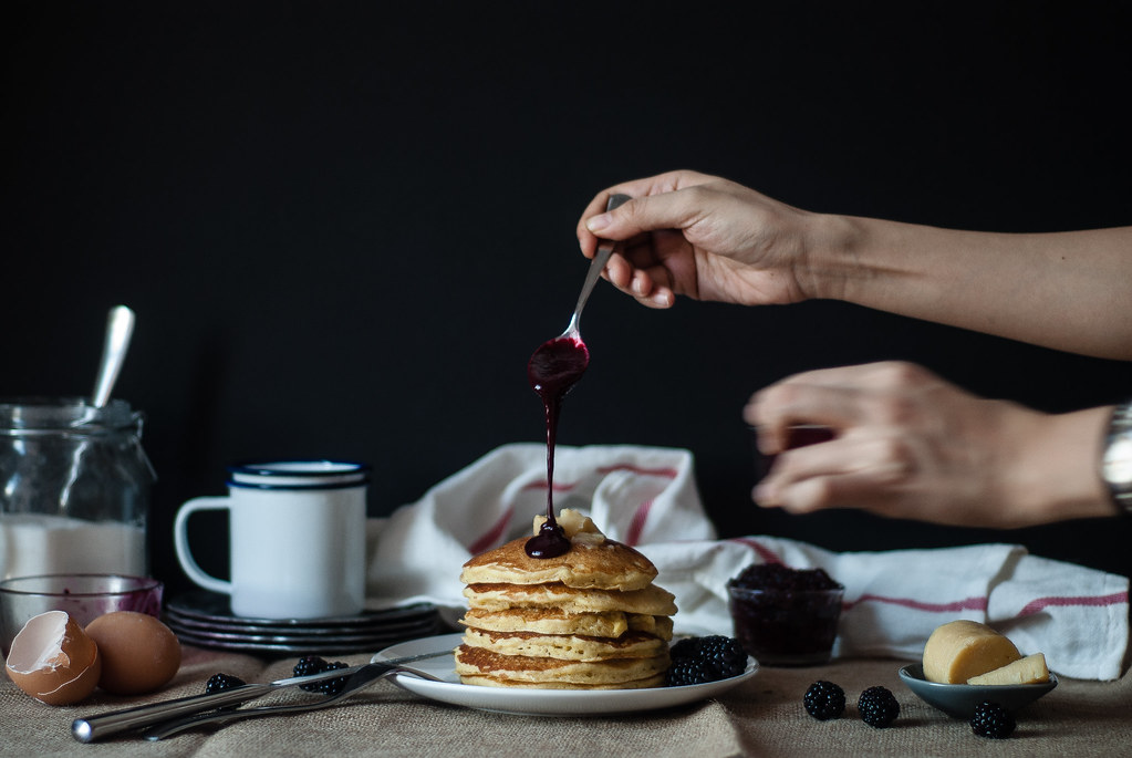 Cornmeal pancakes with blackberry-goat cheese syrup.
