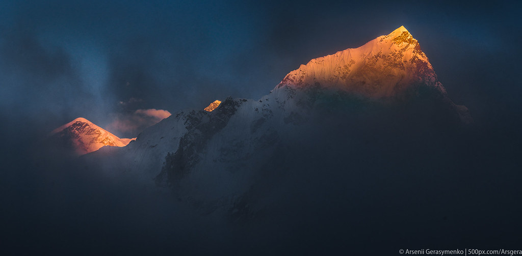 Everest Mt. Peak and Nuptse at cloudy sunset