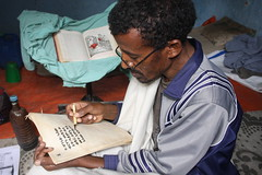 Misganew Andeurgay, 50, copying a religious text onto parchment at Debre Libanos, 100km north of Addis Ababa, Ethiopia. Credit: James Jeffrey/IPS