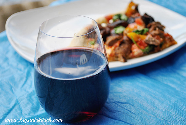 Pinot Noir wine with fajita pizza with steak and fresh peppers