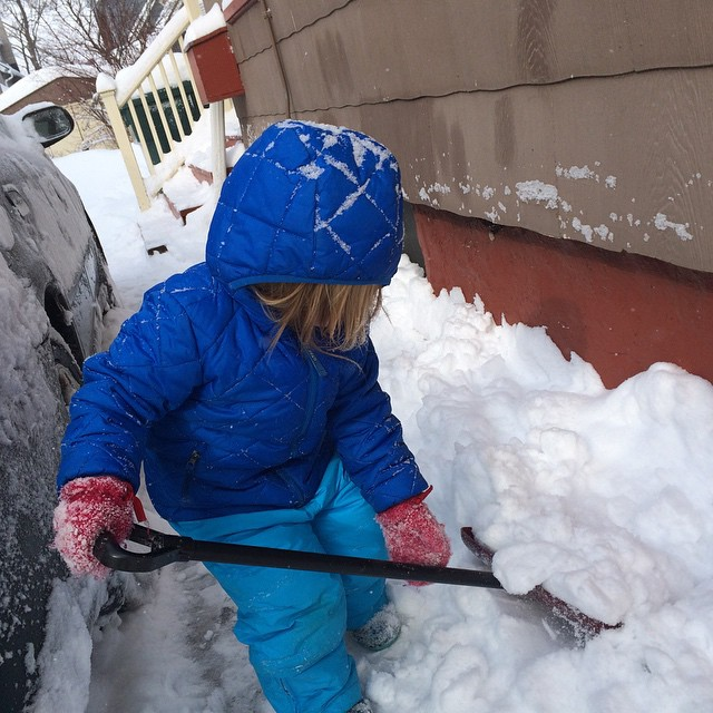 Helping me clear snow before naptime.