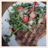 Simply grilled pork chops and arugula salad with tomatoes from the garden, shaved parm, and homemade balsamic vinaigrette. #whatsfordinner