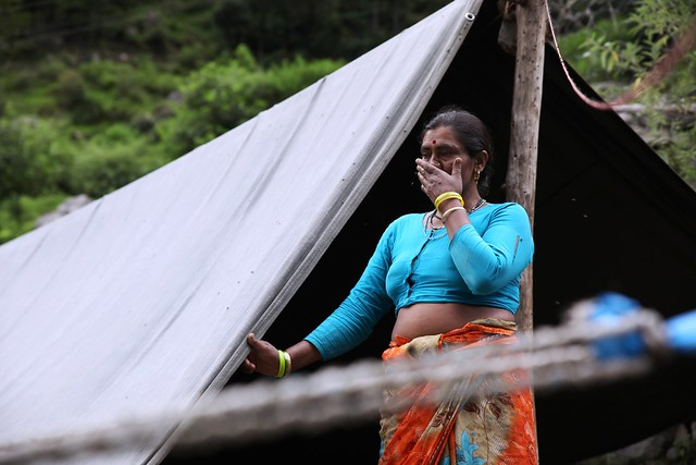 Maheshwari Devi , 41, stands outside a makeshift tent in Govindghat, 19 km from Joshimath town on July 14, 2013, after her house was partially destroyed by floods. Thousands of homes, roads and bridges in the northern Himalayan state of Uttarakhand are in need to repair after the floods and landslides on June 16 and 17. Credit: Nita Bhalla/Thomson Reuters Foundation.