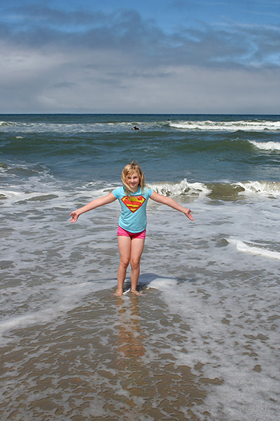 Annalie in the water, *not* getting wet