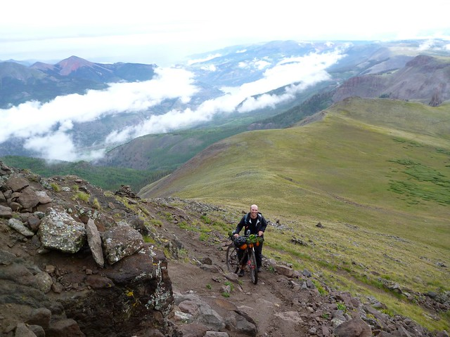 Barry climbing the steep switchbacks on a scree slope