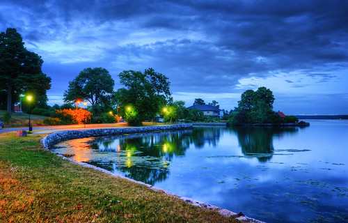 street trees house water grass stone wall clouds reflections landscape island lily bend sweden stockholm dusk villa sverige lamps curve hdr waterscape strandvägen danderyd djursholm
