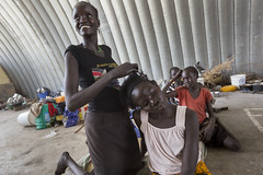 Plaiting hair at UN House, Juba
