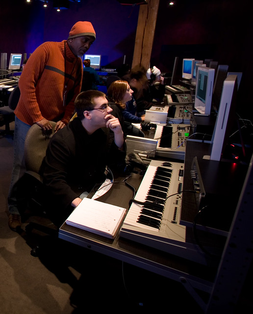 Walter guides students through a music production exercise in Apple Logic