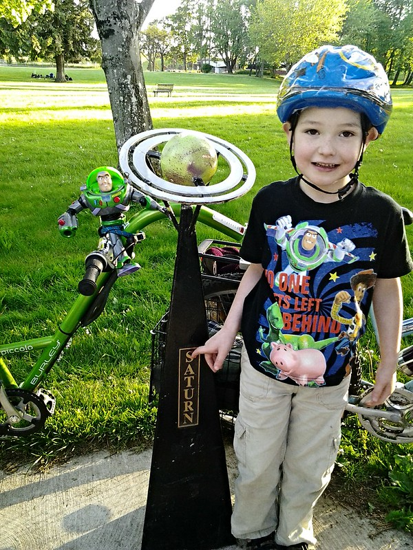 Buzz On a Bicycle and a Boy With Saturn