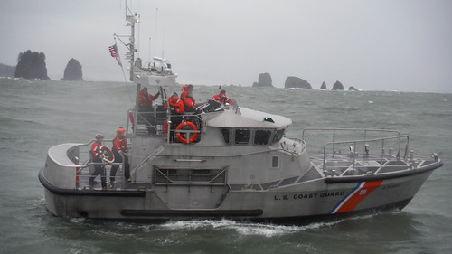 Crew members from Coast Guard Station Quillayute River in La Push, Wash., prepare to lay a wreath into the water in honor of three crew members who lost their lives during a rescue mission in 1997. At the time of the incident, the three crew members were the first Coast Guardsmen to lose their lives in 30 years. (U.S. Coast Guard photo courtesy of Coast Guard Station Quillayute River)