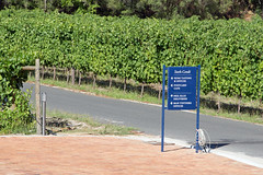 Signboard and vineyards, Stark-Condé Wines