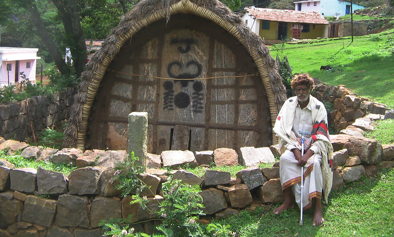 Toda Elder outside a traditional Toda home