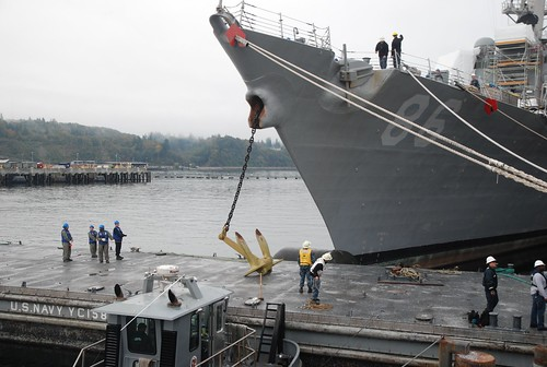 EVERETT, Washington - The crew of the guided missile destroyer USS Shoup (DDG 86) works to install the ship's anchor following successful completion of a six-month ship's restricted availability maintenance period.