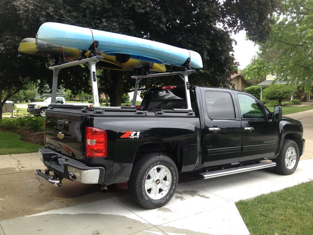 A Rack And Truck Bed Cover On A Chevy Gmc Silverado Sierra