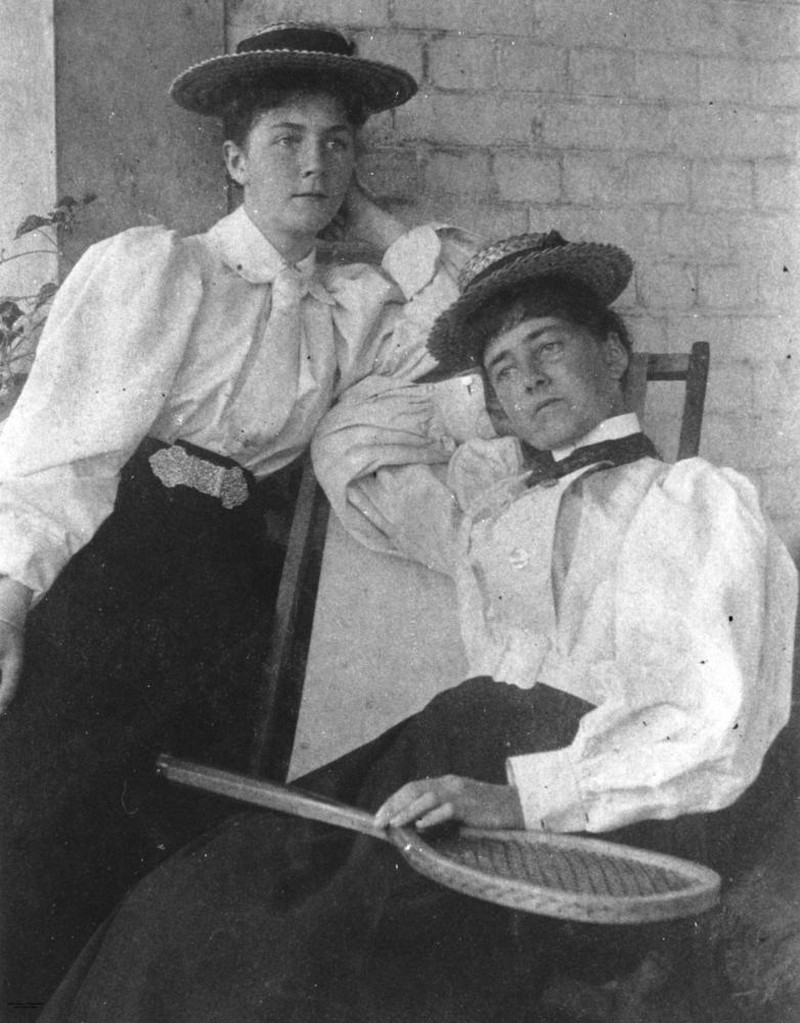 Two women dressed for a game of tennis, 1890-1900