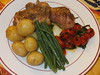 Roast chicken pieces with green beans and roasted vine tomatoes
