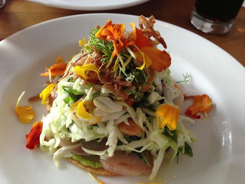 kampachi tostada, herbs, fish sauce vinaigrette, peanut