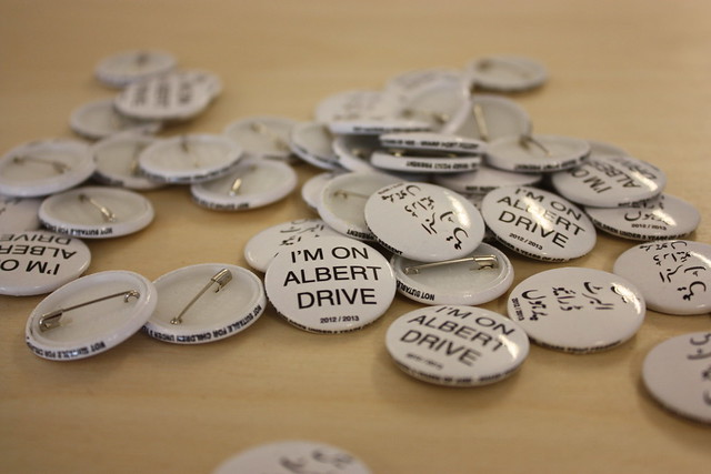 image of I am on Albert Drive badges (in both English and Arabic)
