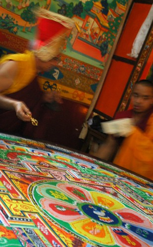 His Holiness Dagchen Sakya circles the Hevajra colored sand mandala to close it by drawing lines with his vajra through the sand, wearing the Sashu hat, assistant monk, Sakya Lamdre, Tharlam Monastery of Tibetan Buddhism, Boudha, Kathmandu, Nepal by Wonderlane