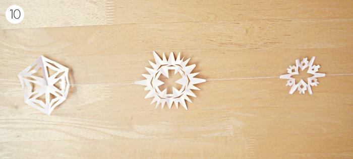 diy christmas paper snowflake garland tutorial